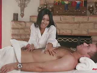 Asian MILF neonate Honey Acolyte massages a cock with say no to shaved pussy