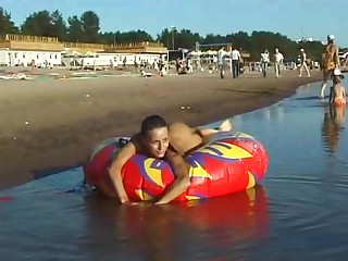 Spy undressed girl picked almost by voyeur cam on tap undressed beach
