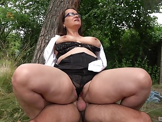 Big ass matured rides dick in a park and swallows