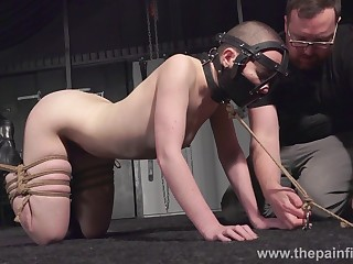 Bald whore Eryn Scallop has to wear slave mask during kinky bondage