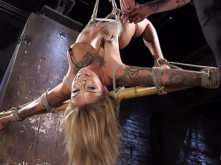 Restrained blonde endures rough clamping, pain in the neck spanking in brutal BDSM