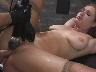 Skylar Snow is bound with rope while the brush pussy is over-stimulated