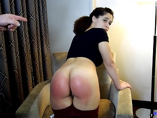 Naughty devilish with curly hair is getting spanked hard, to learn her lesson for the day