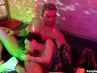 Delightful girls are have fun in a catch night club and having casual sex with random guys