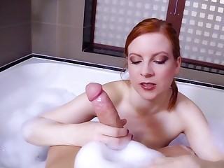 Hot redhead dazzles with will not hear of sensual POV handjob