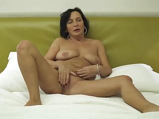 Chubby amateur mature Olivia Westervelt spreads her legs to masturbate